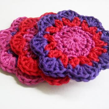 Handmade crocheted flower motif appliques in pink red purple 2,5 inches wide